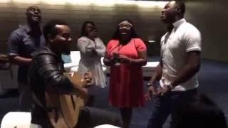 Travis Greene & Micah Stampley sanging, worshipping