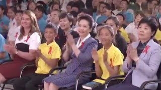 Peng Liyuan addresses opening of summer camp for HIV/AIDS kids