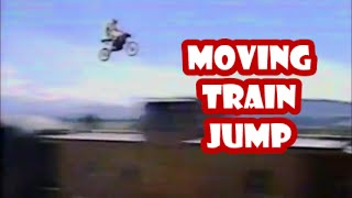 AMAZING!  motorcycle jump over moving train JOHNNY AIRTIME