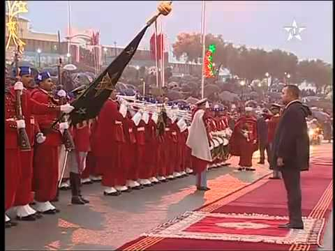 The king Mohammed VI greets the national moroccan anthem in the rain