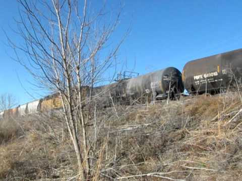 Union Pacific mixed freight with slug and mid-train DPU