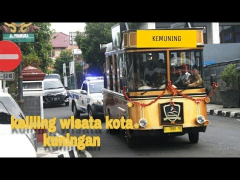 bus-kemuning-transportasi-wisata-keliling-kota-kuningan