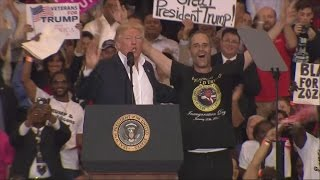 Trump invites eager supporter on stage, hailing him