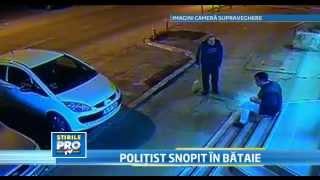 IMAGINI SOCANTE. Politist batut in plina strada.