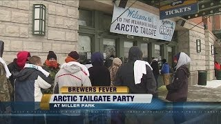 "Fans attend ""Arctic Tailgate Party"" despite cold temperatures and snow"