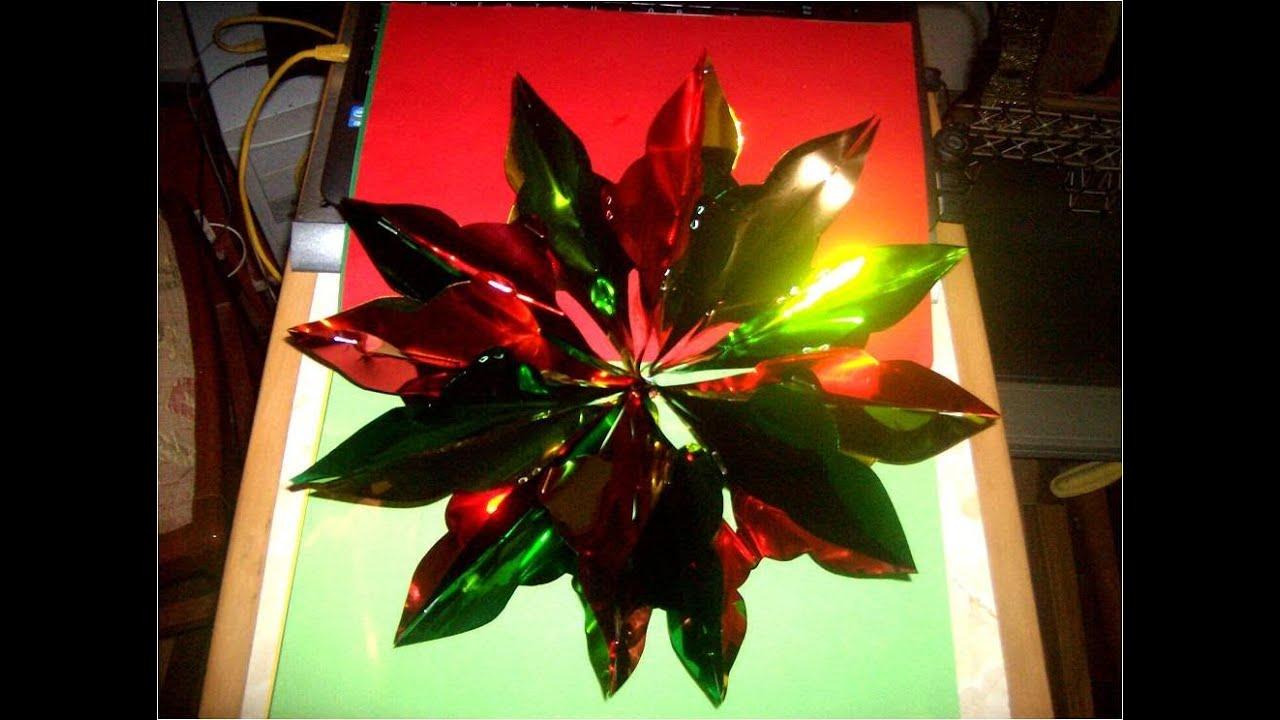 Manualidades navide as estrella colgante de papel met lico for Adornos con plantas de nochebuena