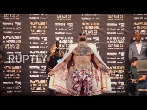 Thumbnail: USA: 'I'm half black from the belly button down,' McGregor tells NYC crowd amid racism controversy