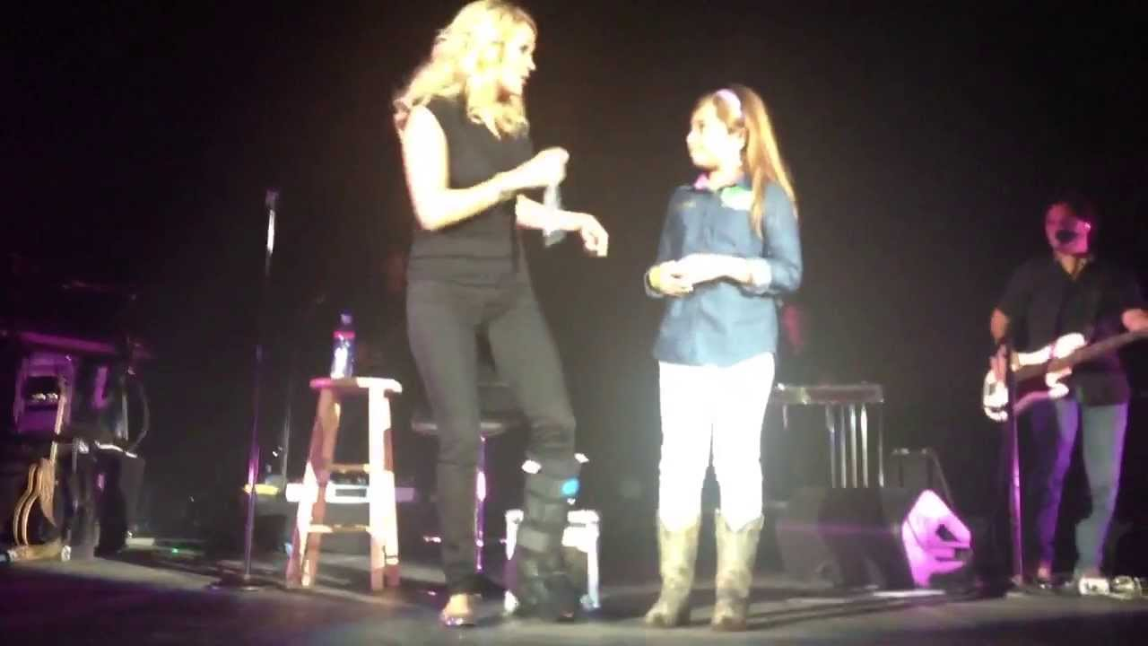Little girl sings for carrie underwood and takes over the stage