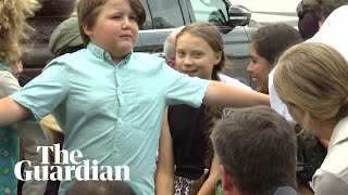 Young boy shields Greta Thunberg from photographers on Capitol Hill