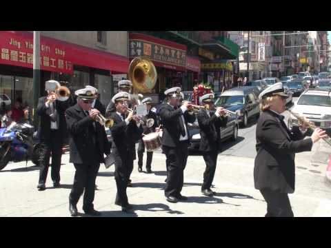 The Green Street Mortuary Marching Band leads a Chinese funeral