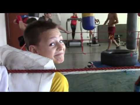 boys ,sparing partener on boxing gym and the Stroe girls look the show