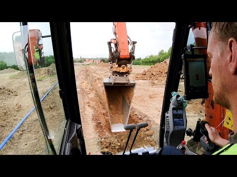 Hitachi Zaxis 250LC-6 Excavator Digging A Water Main Trench With A V-Bucket