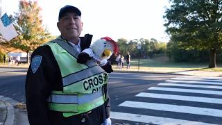 Arlington crossing guard surprised with Nationals World Series tickets