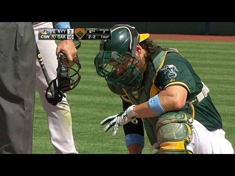 NYY@OAK: A's catchers get ready to enter the game