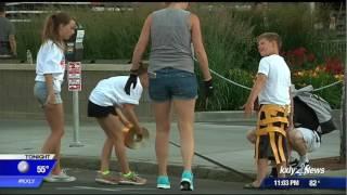 Volunteers tape down Hoopfest courts