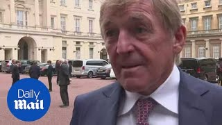 Former football legend Kenny Dalglish is knighted by Prince Charles