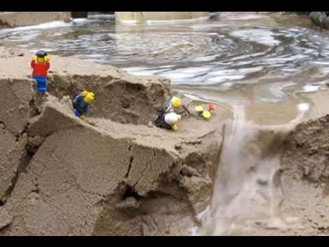 Dam breach:  lego men in danger by the flood...