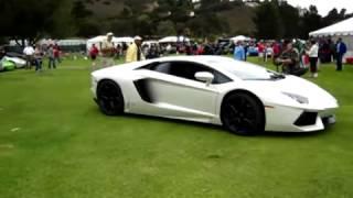 Jay_Leno_driving_Lamborghini_Aventador_at_Concorso_Italiano_20114