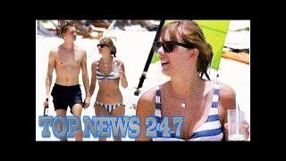 Taylor Swift and Joe Alwyn enjoy drinks on the beach
