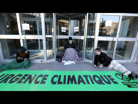 Environmentalists chain themselves to the doors of Quebec Premier's office in Montreal