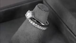 Комплект колец (обручальные + помолвочное) из белого золота с бриллиантами