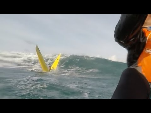 Watch This Guy Crack a Surf Ski Kayak in Half as He Paddles Out