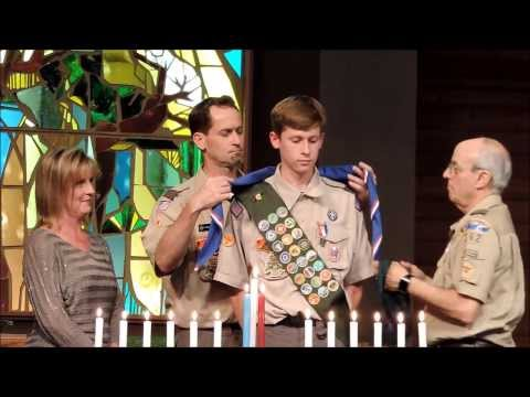 Pinning on the Eagle Scout Badge.