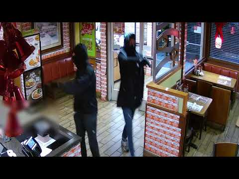 Michael J. - Two masked armed men rob a Denny's, shooting two. Police ask for help