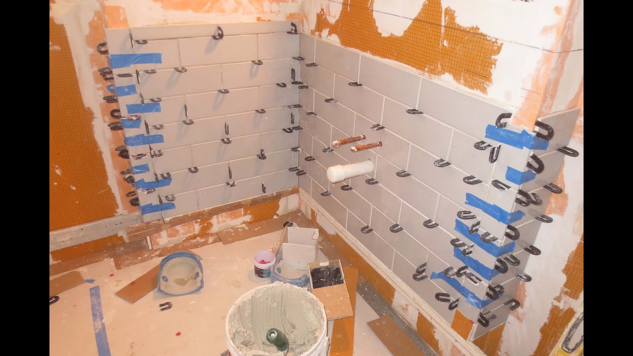 Complete bathroom schluter systems products part 4 lower subway tile install youtube Bathroom wall tiles laying designs