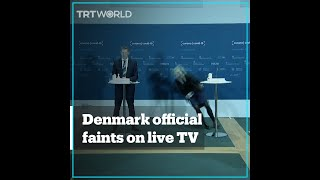 Denmark official faints during Covid-19 conference