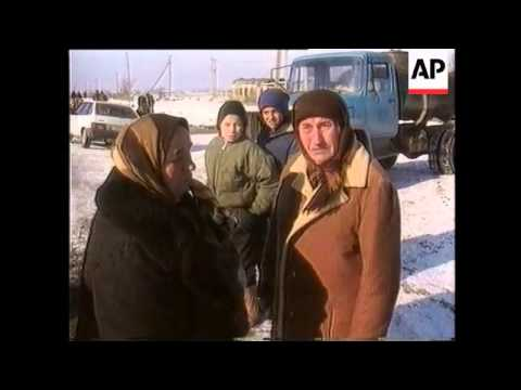 Chechnya - Refugees Flee Fighting In Gudermes