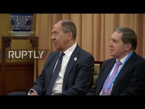 China: I 'don't recommend' smoking, Putin jokingly tells Zeman and Lavrov