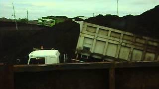 How does loading coal on barge at Kelang river Palembang Indonesia
