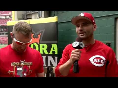Joey Votto presents Zack Cozart with his new All-Star donkey
