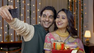 Smiling Indian couple taking selfie after Karwa Chauth celebrations - capturing memories