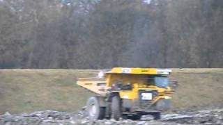 komatsu HD 785 and cat 777 dumping with D9R dumping