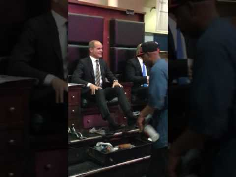 Kevin Spacey and Michael Kelly get their shoes shined in Union Station.