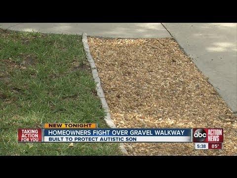 Homeowners fight over gravel walkway