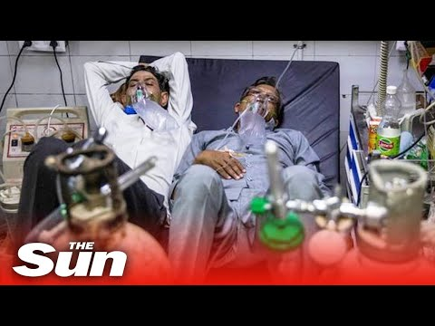 Two to a bed in Delhi hospital as India's COVID-19 crisis spirals out of control