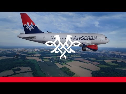 Air Serbia A319 escorted by a pair of Mig-29's