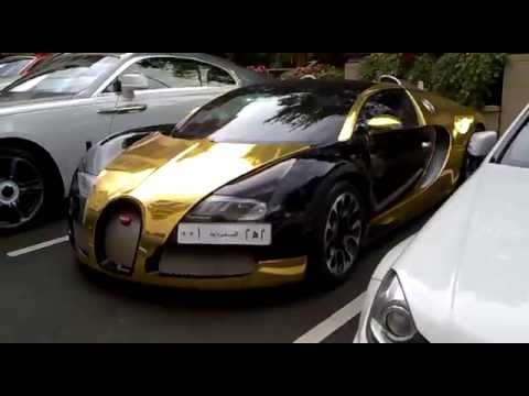 Black Gold Bugatti Veyron And White Lamborghini Aventador At The