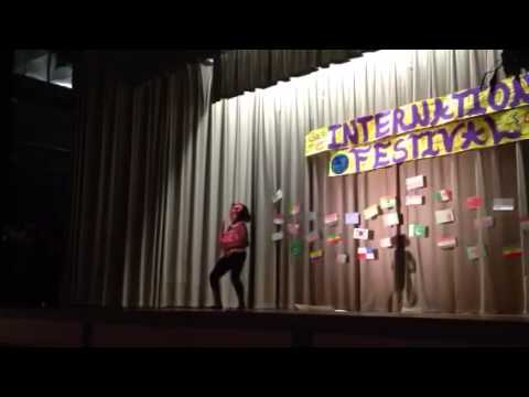 Eight years old dancing Angolan song