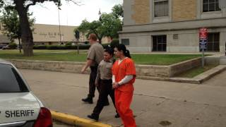 isidro delacruz is escorted out of the courthouse in chains