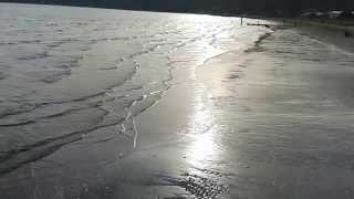 Free Video Background 2: Ocean Waves Lap Sea-Shore, Sun Sets Behind the Hills 2, No Sound