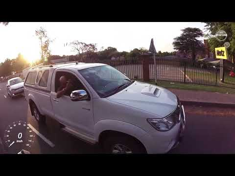 Taxi riding into oncoming traffic, Sloane Street, Bryanston
