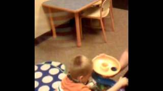 Aiden using PECS to communicate what toy he wants to play with, als...