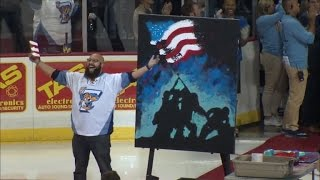 Watch Talented Man Sing National Anthem While Painting Artwork at Same Time