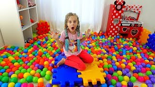 Ulya and colored balls in the room