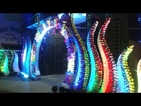 welcome-gate-decoration-with-multicolour-artificial-flowers-&-colourful-uplighting-for-wedding-party