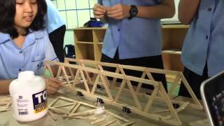 One of the teams in the KIS Design Cycle Challenge popsicle stick bridge building design challenge.